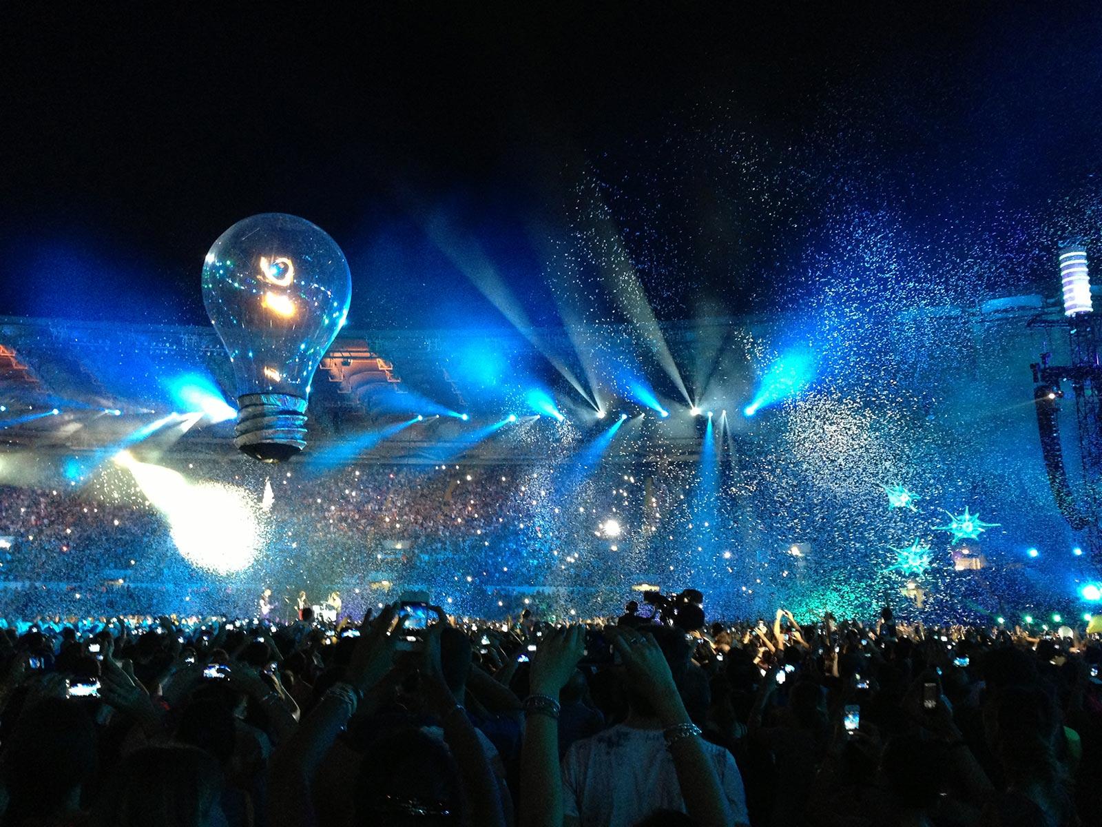 Cirque Bijou - A giant lightbulb flies over crowds at Muse stadium tour