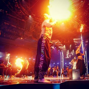 A performer breathes fire on stage with Janet Jackson at the MTV Europe Music Awards, Bilbao