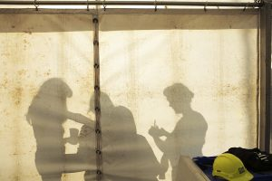 A silhouette of performers getting ready backstage. Portolan, Sunderland Tall Ships, Cirque Bijou. Image Dan Prince.