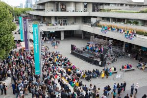 Extraordinary Bodies' What Am I Worth? audience gather at National Theatre River Stage, image Rob Harris.