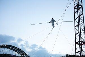A shot from below showing Chris Bullzini walking along the wire. Portolan, Sunderland Tall Ships, Cirque Bijou. Image Dan Prince.