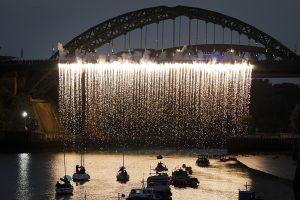 A pyrotechnic waterfall cascades from the River Weir Bridge. Portolan, Sunderland Tall Ships, Cirque Bijou. Image Mark Pinder.